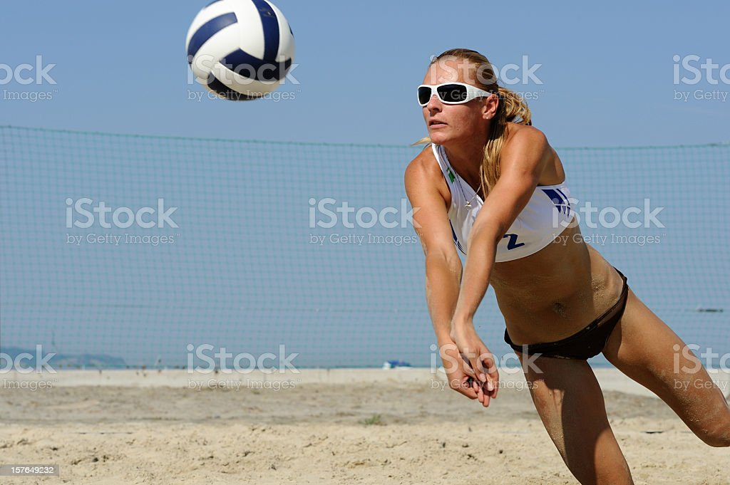 Beach volley attractive action stock photo