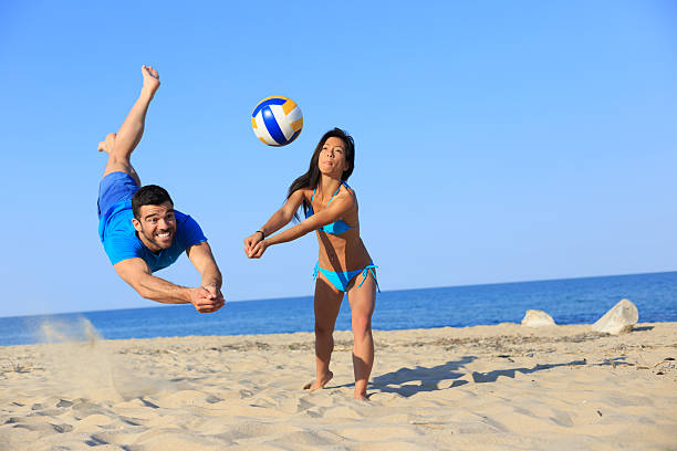 Beach volley in action stock photo