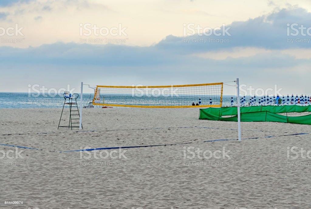 Beach volley net near sea blue water, field close up stock photo