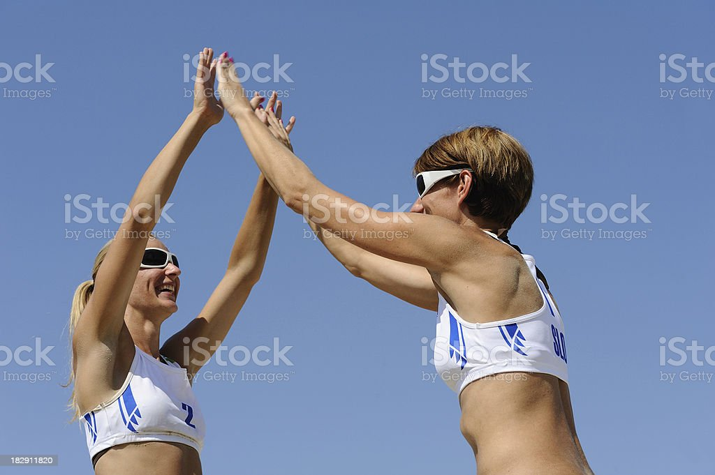 Beach volley players winning the match royalty-free stock photo