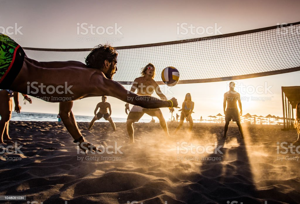 Beach volleyball at sunset! stock photo