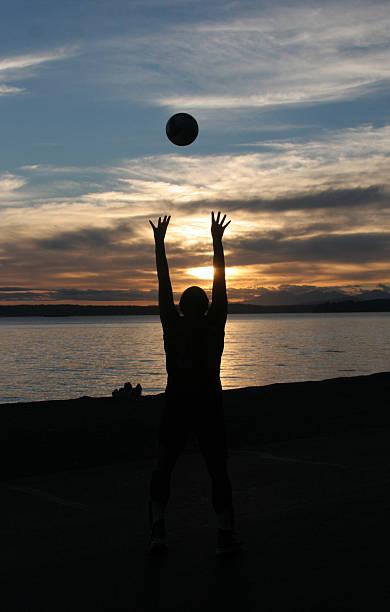 Beach Volleyball at Sunset stock photo