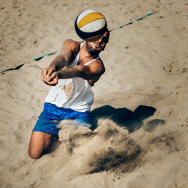 Beach volleyball dig stock photo