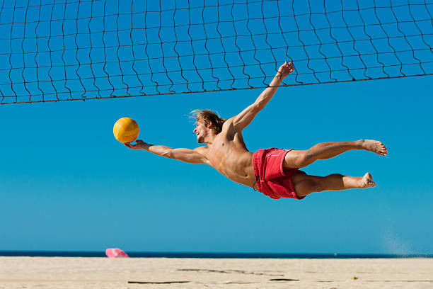 Beach volleyball - man jumping stock photo