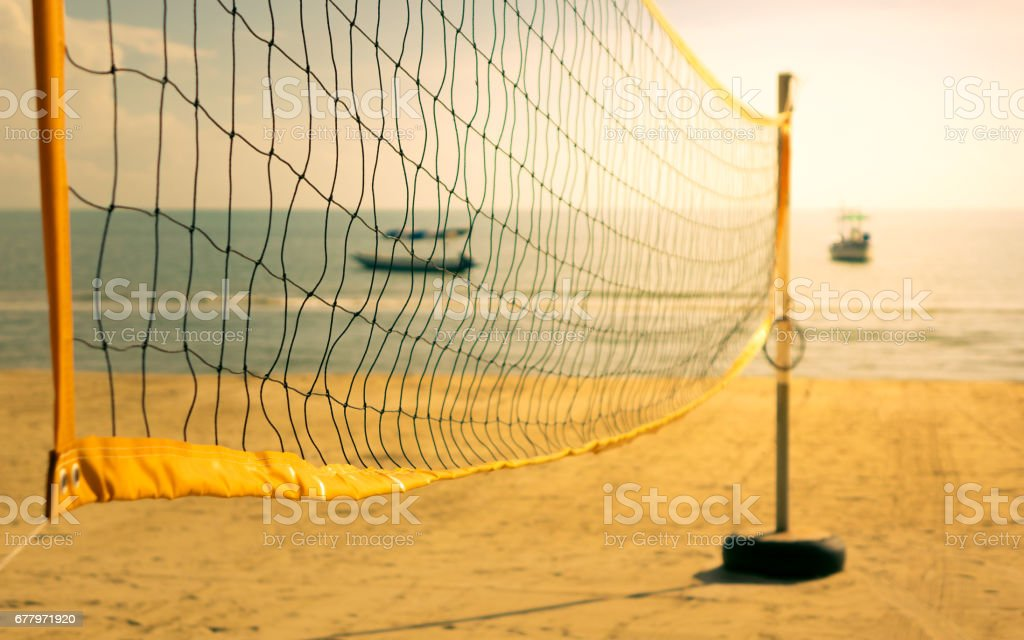 Beach volleyball net on the beach with warm tone stock photo