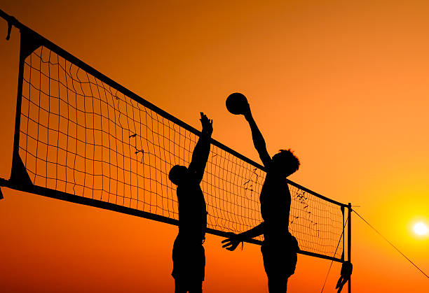 beach volleyball silhouette stock photo