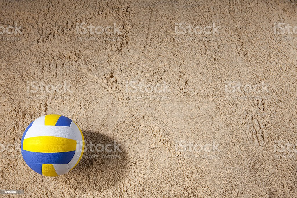 Beach volleyball sitting on the sand stock photo