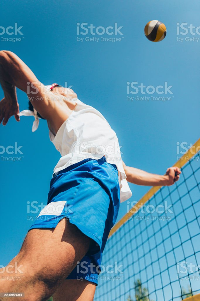 Beach volleyball spike shot stock photo