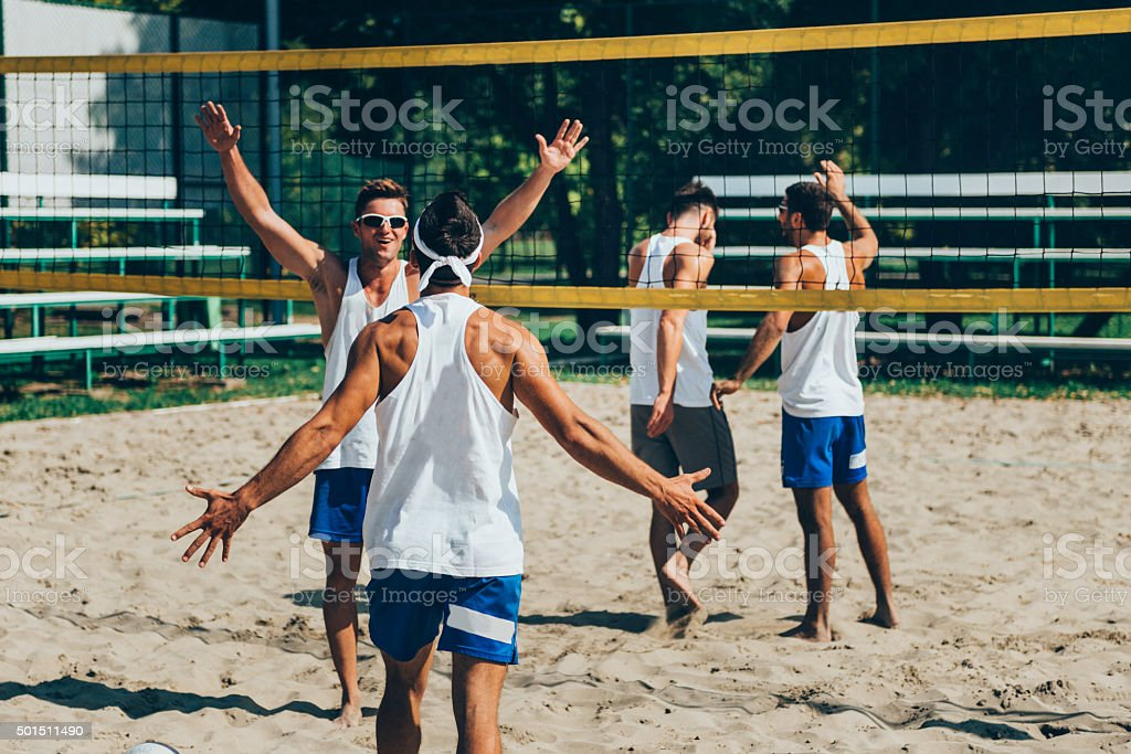 Beach volleyball team winning an important point stock photo