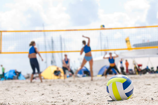Beach Volleyball with closeup of ball in foreground stock photo