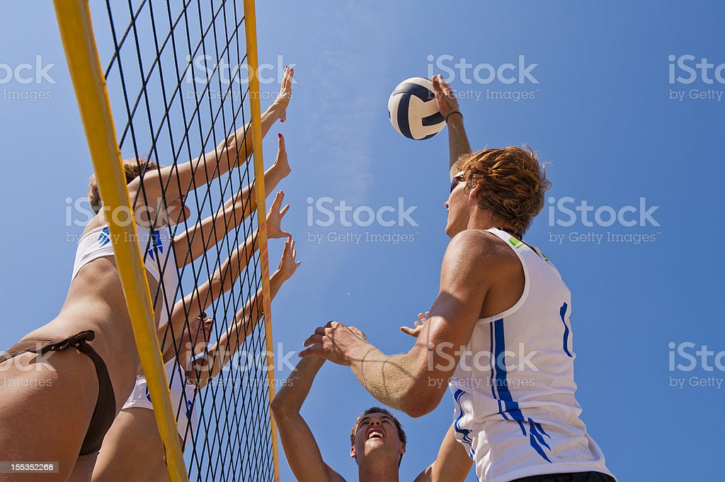 Beach volleying action stock photo