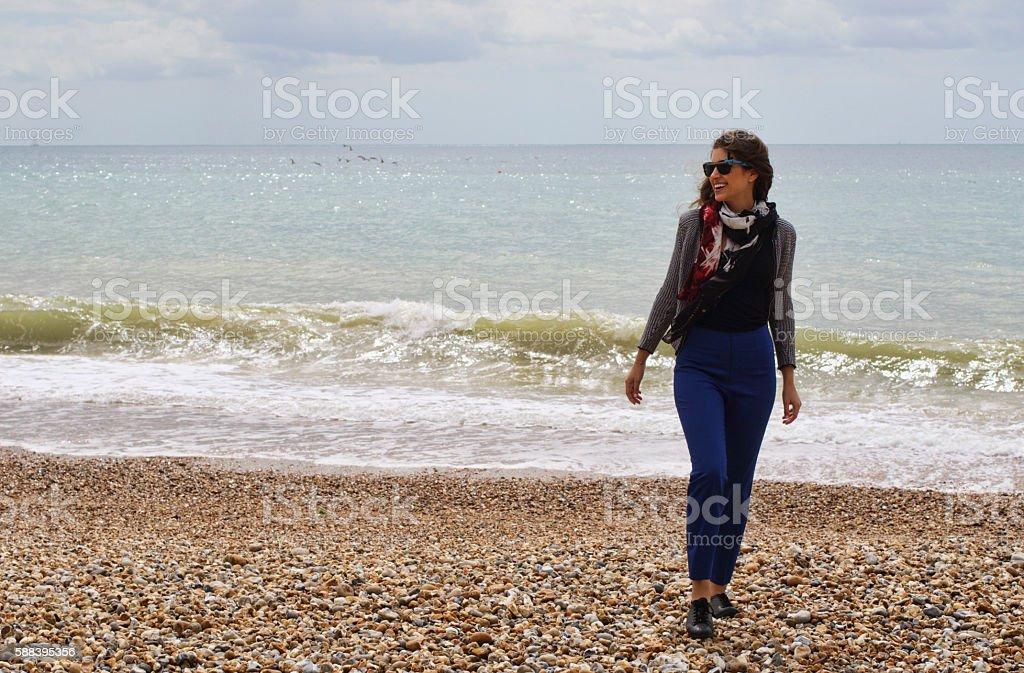 Beach walking by the sea Hengistbury Head Russian outdoor girl stock photo