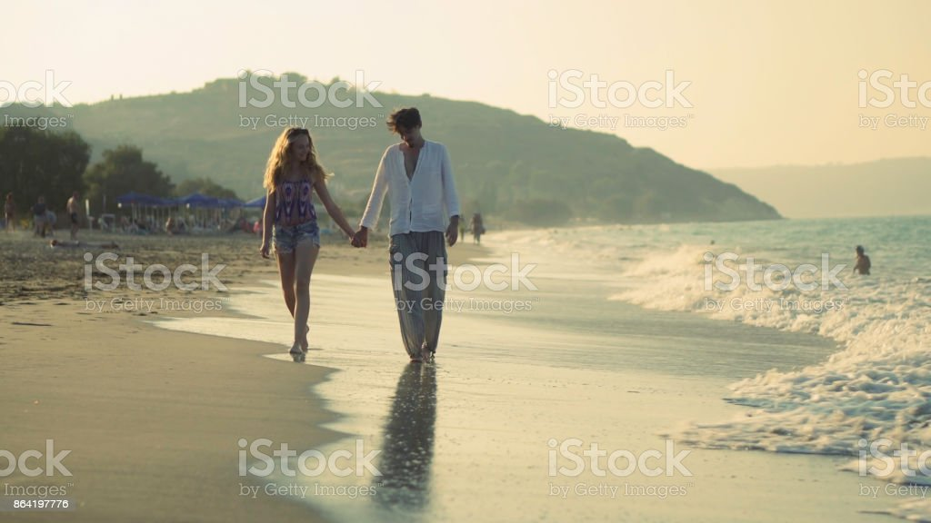 Beach walking towards royalty-free stock photo