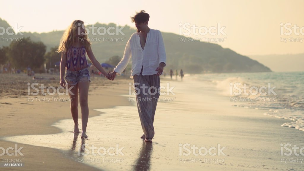 Beach walking towards royalty-free stock photo