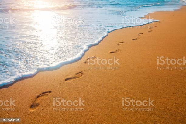 Beach wave and footprints at sunset time picture id904033408?b=1&k=6&m=904033408&s=612x612&h=u9dcqrz29n2z tombmymsukpmugliwtcwcq cvaheti=