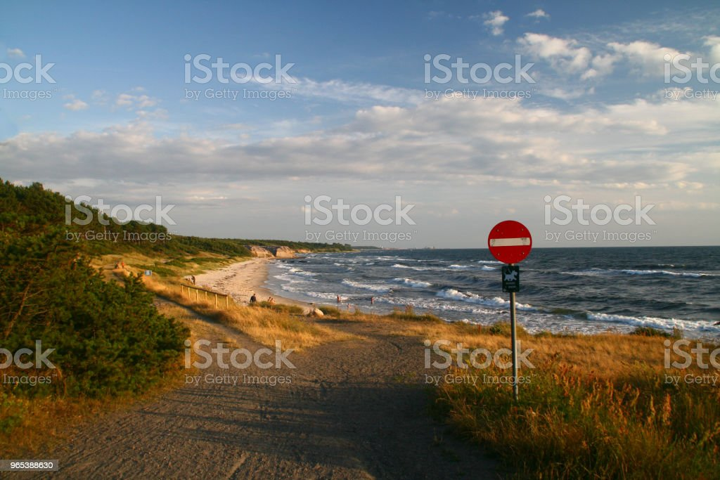 Beach with a warning sign zbiór zdjęć royalty-free