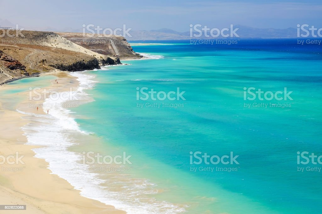 Beach with amazing water colors on Fuerteventura, Spain. stock photo