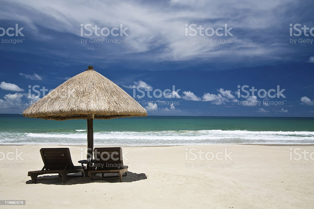Beach with an umbrella and chairs, copyspace royalty-free stock photo