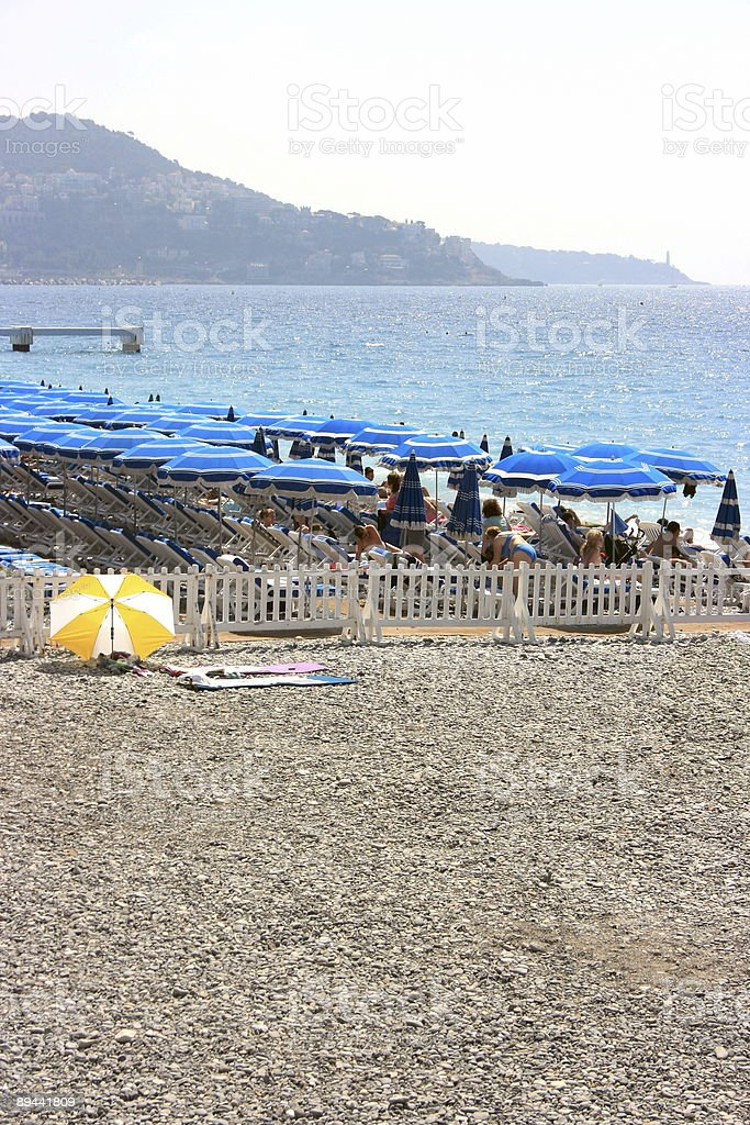 Beach with blue umbrellas 2 royalty-free stock photo