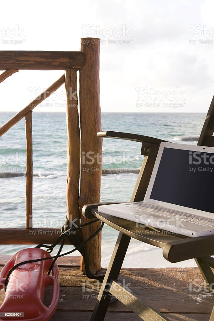 Beach with Empty Lifeguard Station and Laptop, Copy Space royalty-free stock photo