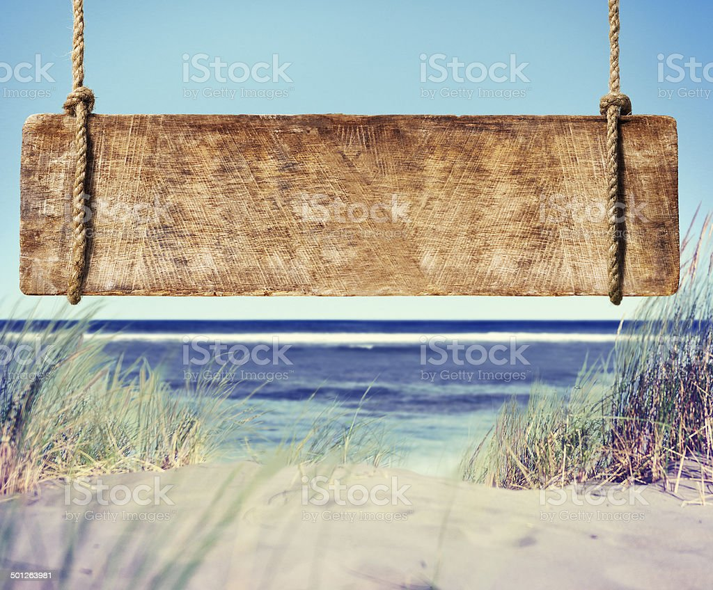 Beach with Empty Plank Sign stock photo