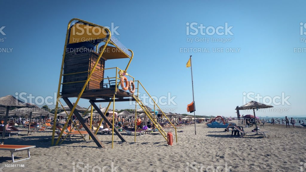 Beach with lifeguard tower and coastline life guard on luxury resort in Durres, Albania stock photo