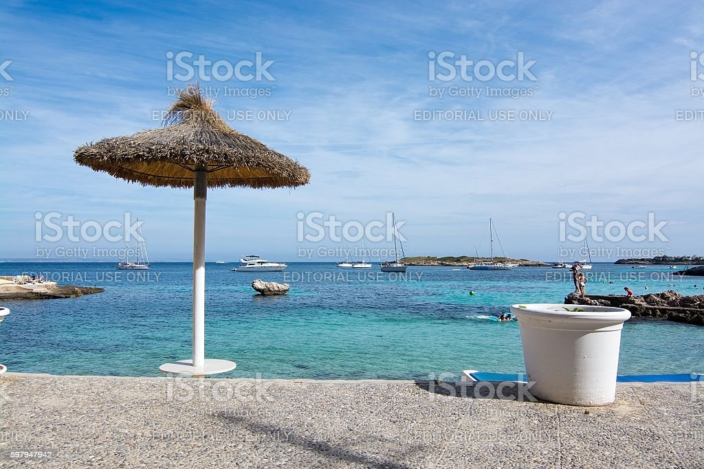 Beach with parasol and flower pots stock photo