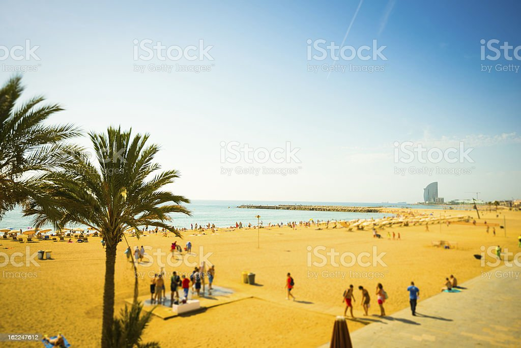 Beach with Parasol in Barcelona, Spain stock photo