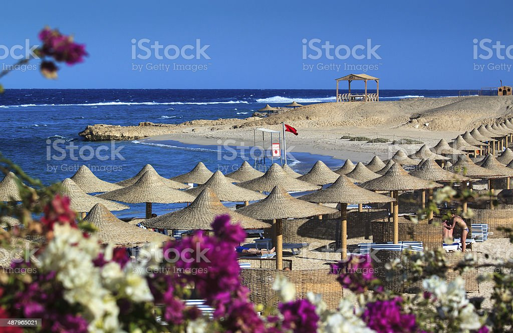 Beach with parasols on the reef stock photo