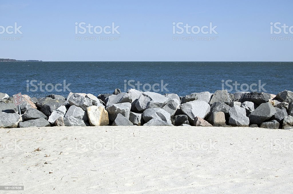 Beach with rocks and skyline stock photo