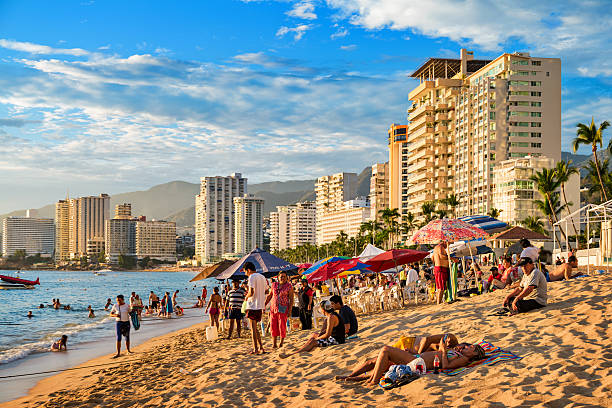 Beach with Row of Hotels and People in Acapulco Mexico stock photo
