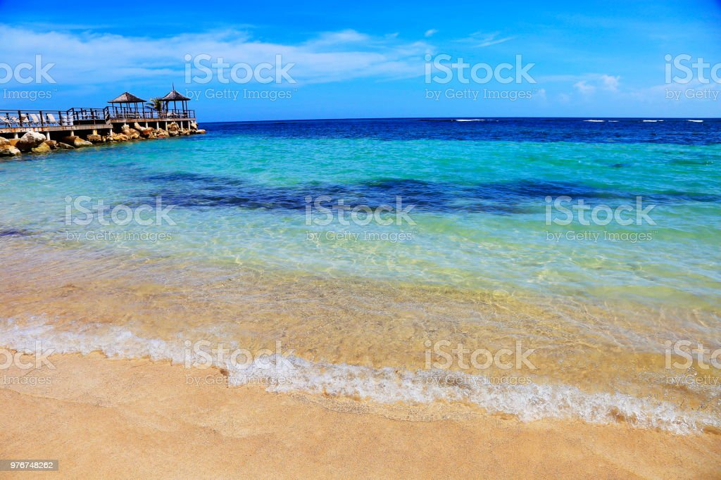 Beach with rustic gazebo on breakwater – Montego Bay - Jamaica, Caribbean sea stock photo