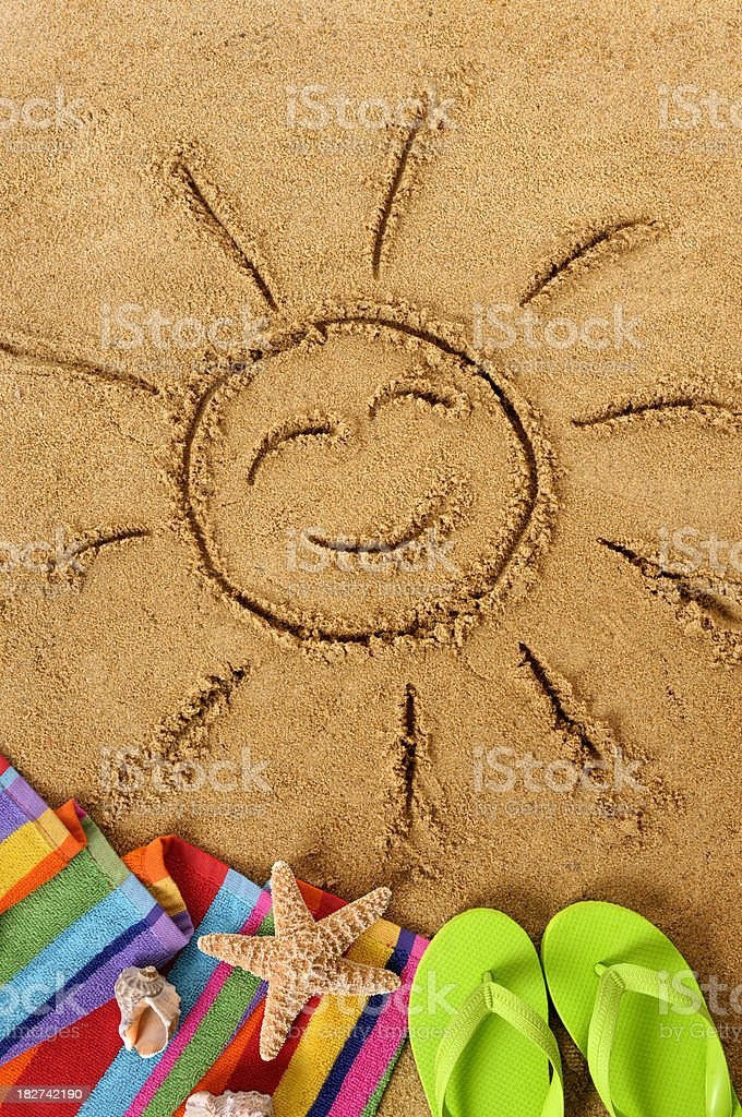 Beach with smiling sun stock photo