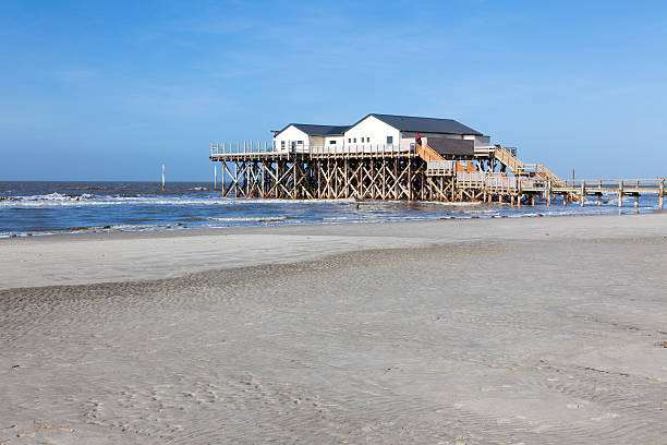 Beach with stilt house, Sankt Peter-Ording, Germany stock photo