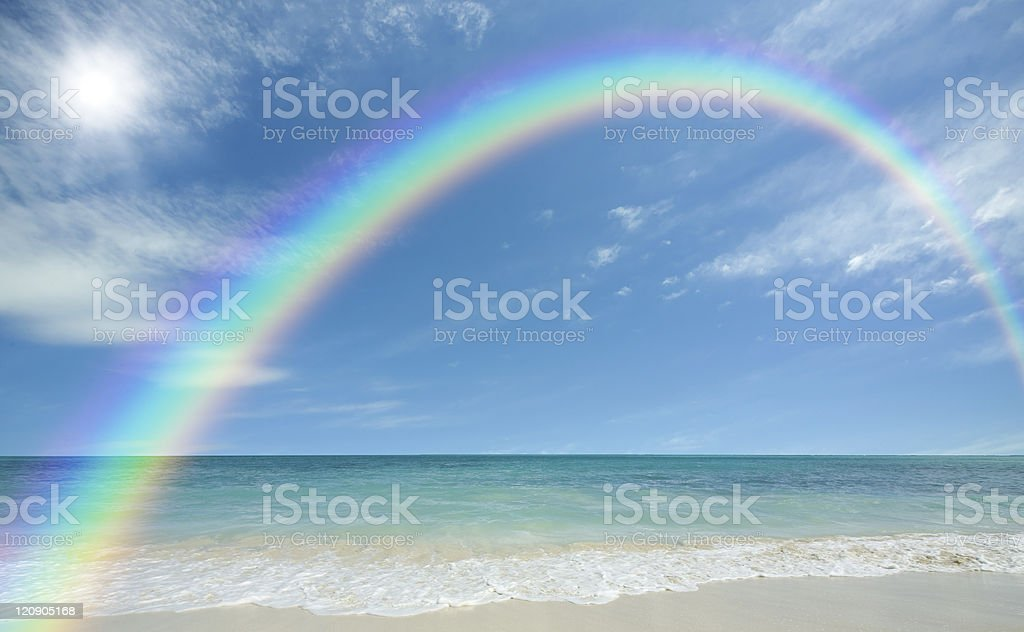 beach with sun and rainbow royalty-free stock photo