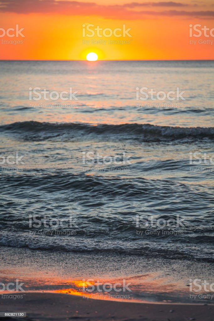 beach with sunset stock photo