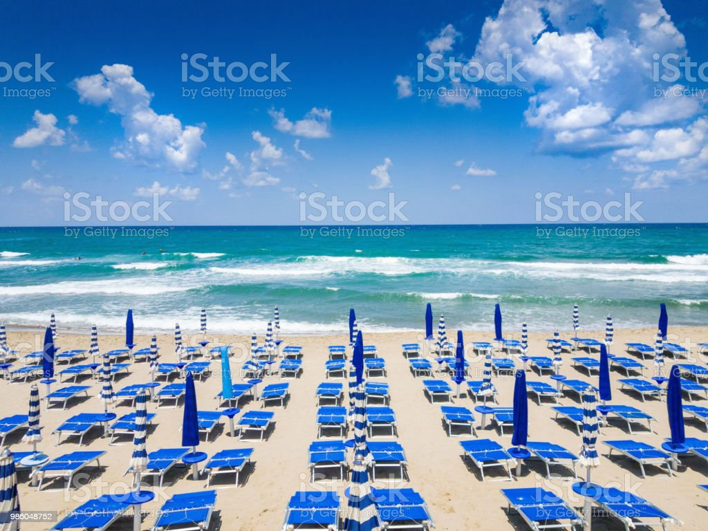 Beach with umbrellas and beach chairs stock photo