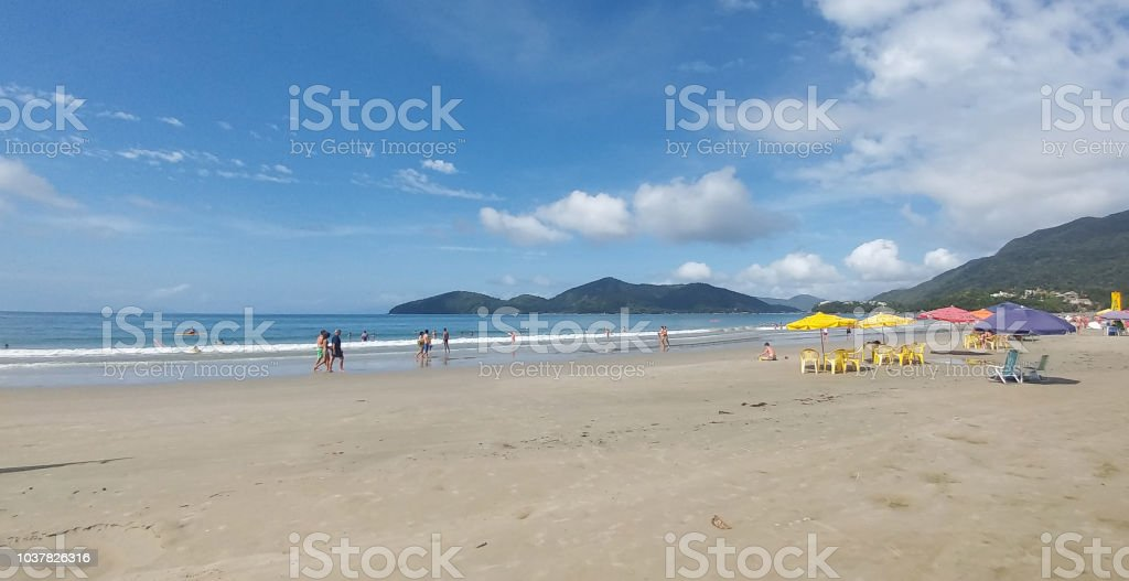 Beach with umbrellas and sunbeds on beach stock photo