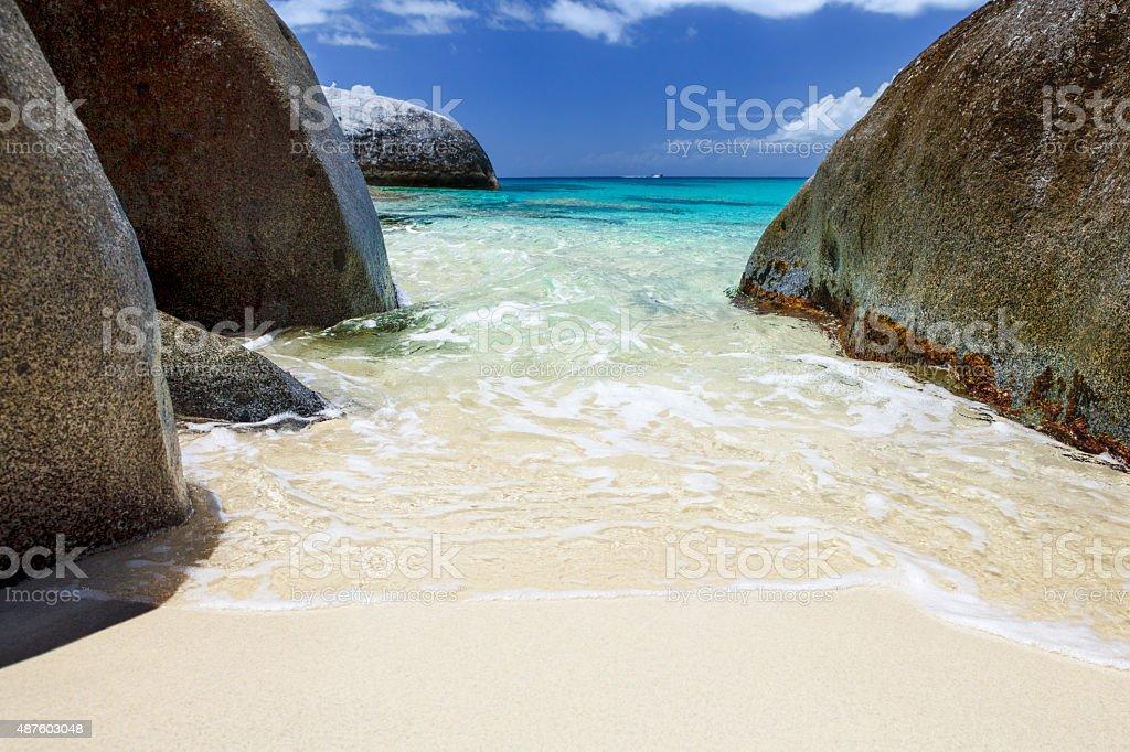 beach with volcanic boulders at Spring Bay, Virgin Gorda, BVI stock photo