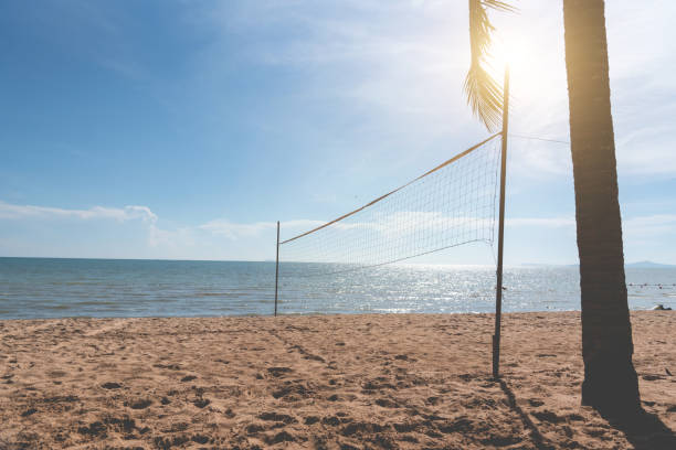 Beach with Volleyball net. Seascape and ocean concept. Summer and Vacation theme. Sunshine element. Vintage matte tone stock photo