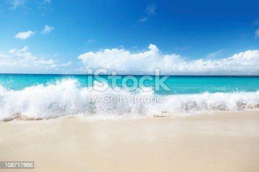 istock Beach with waves crashing onto the sand 108717886