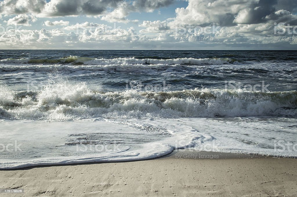 Beach with white water waves stock photo
