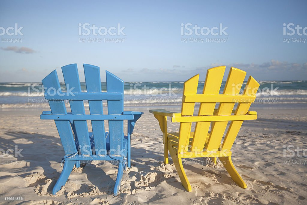 Beach wooden chairs for vacations in Tulum, Mexico royalty-free stock photo