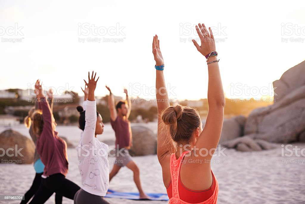 Beach yoga is a full mind, body and soul experience stock photo