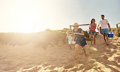 Shot of a young family arriving at the beachimage806237.jpg