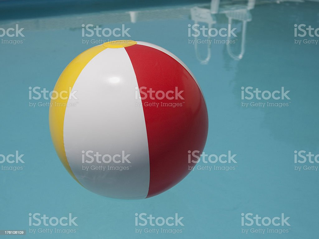 Beachball floating in pool royalty-free stock photo