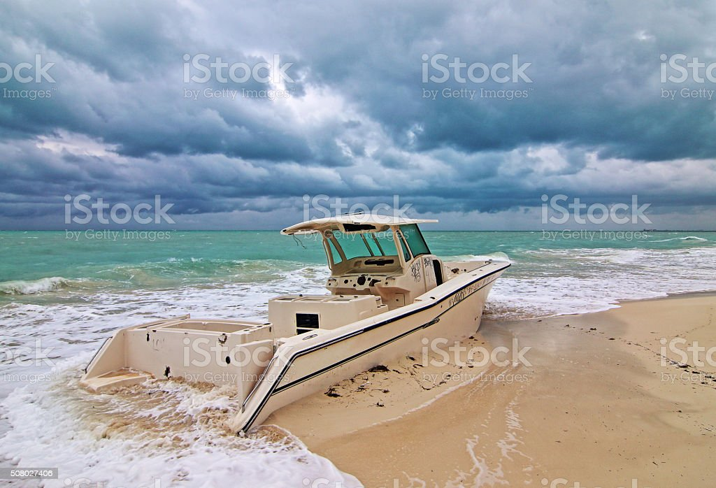 Beached Abandoned Wrecked Fishing Boat Isla Blanca Cancun Mexico stock photo
