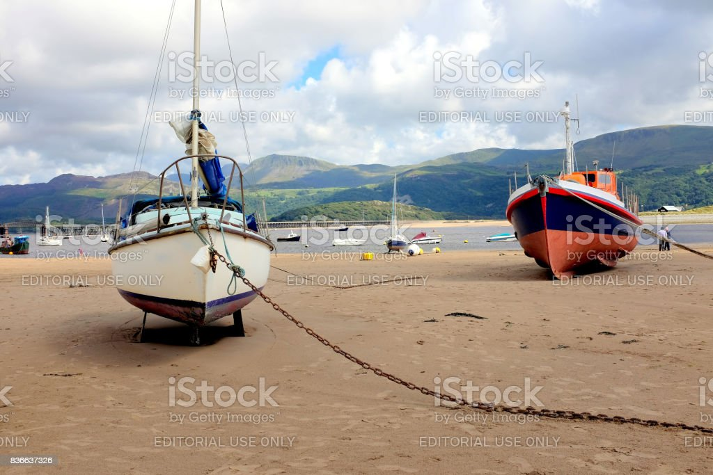 Beached boats, Barmouth, Wales. stock photo