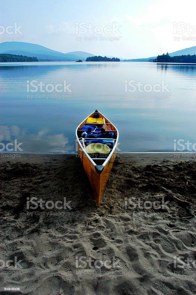Beached canoe in the Adirondacks royalty-free stock photo