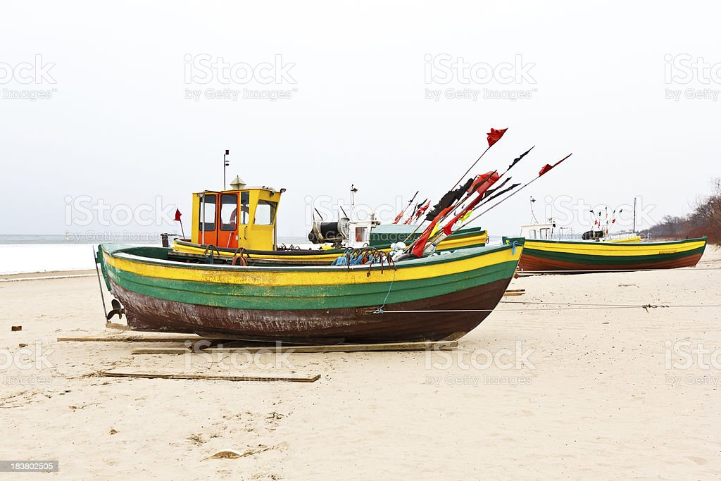 Beached Fishing Boats in Winter royalty-free stock photo